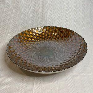 Peacock serving platter in gold tones.